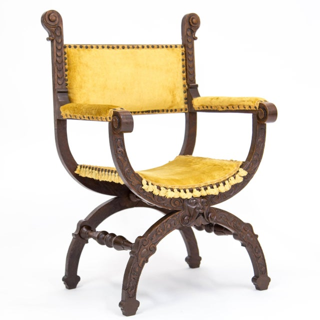 Early 20th C. Savonarola or Dante chair in the Italian Renaissance style. The padded rectangular back, armrests and seat...