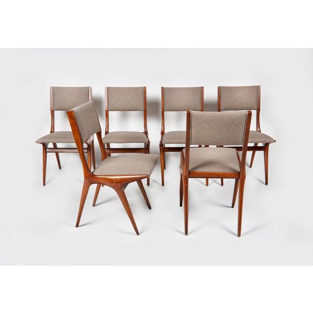 Rare set of 6 Carlo de Carli chairs model 158 All in Italian walnut. The backrest and the seat have been upholstered in...