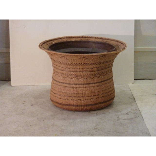 Large African woven basket with heavy weight copper liner to use as a cachepot for a large plant, the liner diameter at...