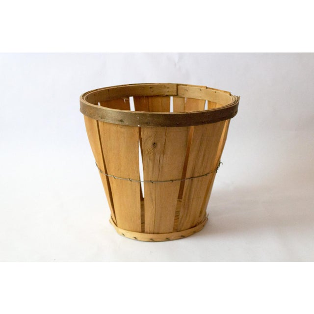 A classic vintage apple basket to add a rustic touch to your space. Perfect for storing everyday odds and ends that need...