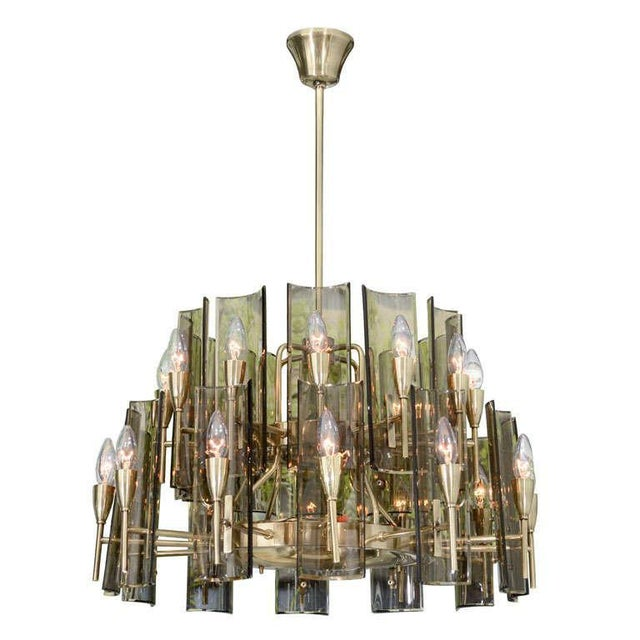 Part of the series with our other sconces, large-scale chandelier with twenty-four lights and amber glass panes.