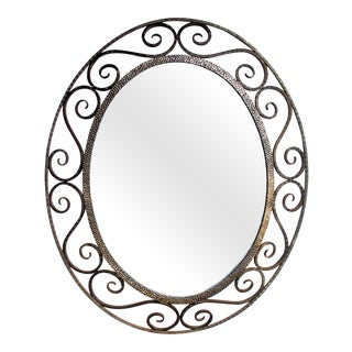 A French Art Deco Openwork Iron Oval Mirror in the Style of Edgar Brandt For Sale