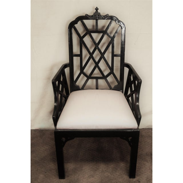 Set of six Classic chinoiserie inspired dining chairs. The set has 2-arm and 4 side chairs, feature a pagoda detail to the...