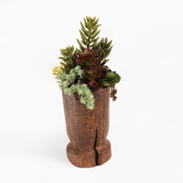 Vintage Indian wood urn with faux succulent arrangement. This piece is very lifelike but no water needed! It makes for a...