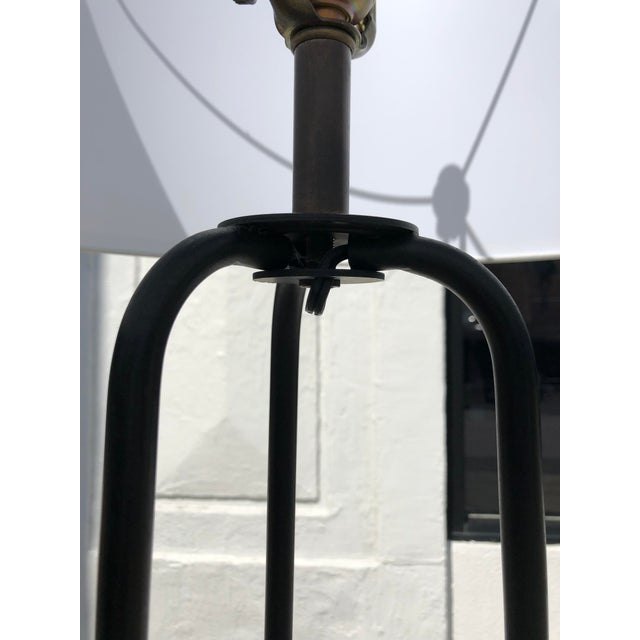 Minimalist iron tripod floor lamp with round block finial a brand new white lamp shade. In beautiful condition and looks...