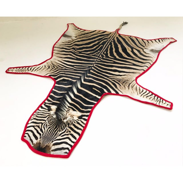 Forsyth's master upholsterers expertly trimmed this zebra hide rug in luxurious red velvet. The hue adds the perfect POP...