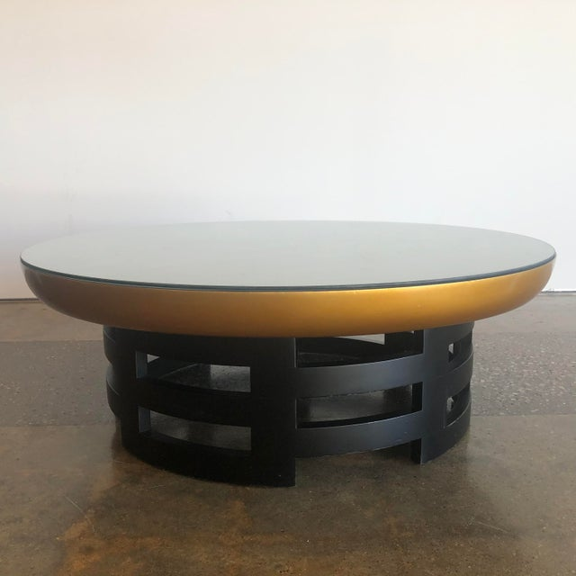 Glamorous, low circular coffee table with glass top, designed by Theodore Muller and Isabel Barringer for Kittinger. Table...