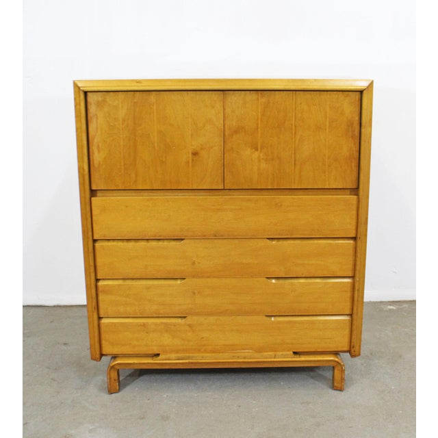 Offered is a beautiful Mid-Century Modern tall chest with ample storage space, which was designed by American designer...