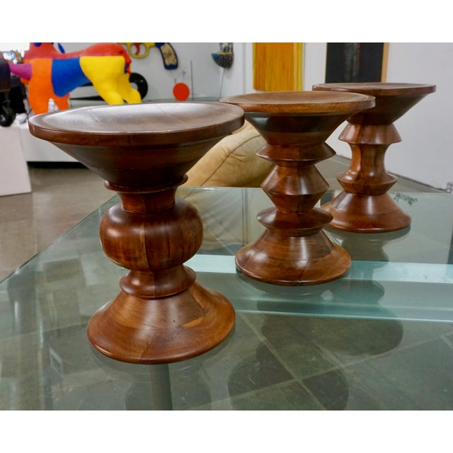 Complete set of 3 Time-Life walnut stools by Charles Eames for Herman Miller. Restored.
