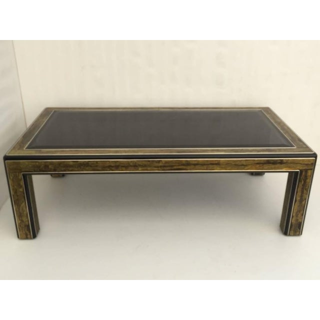 Bernhard Rohne acid etched brass coffee table for Mastercraft with black glass top. Made in the 1970s.