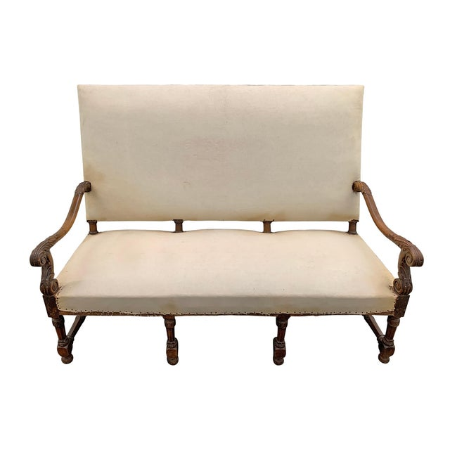 An incredible 17th century French Louis XIV period settee with a wide perfectly pitched square back, eight turned legs...