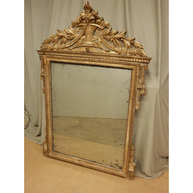 18th century French Directoire' gilt mirror with original glass.