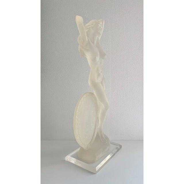 Vintage lucite nude female sculpture, circa 1980's in excellent condition.