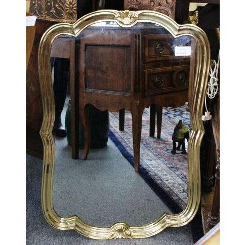 Heavyweight sturdy Italian brass mirror in art nouveau turned style.