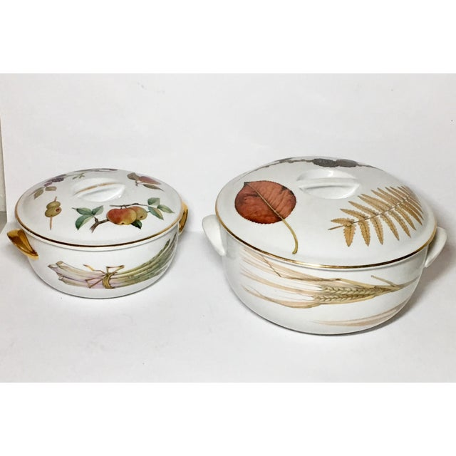 These are oven to table vegetable casseroles with lids. One has gold trimmed handles, the other does not. Smaller is 6...