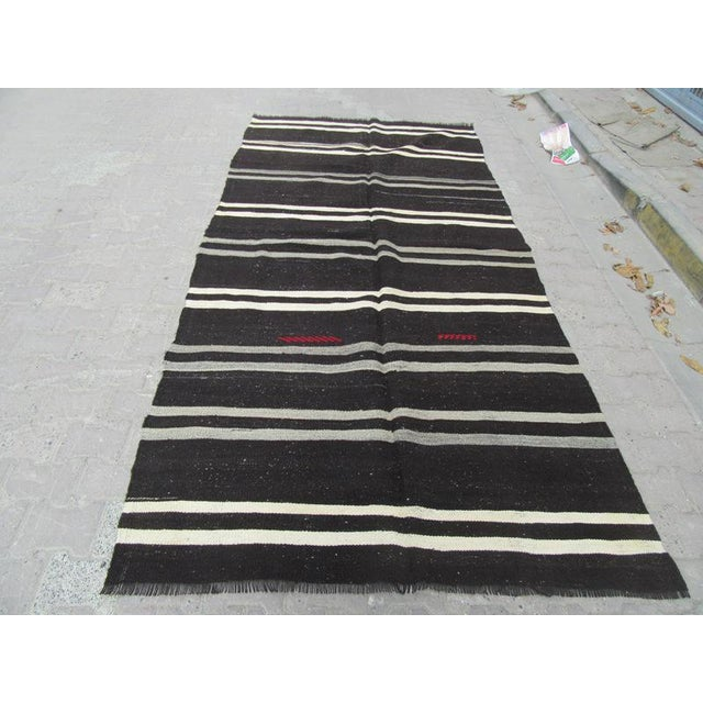 Vintage striped kilim rug from Afyon region of Turkey. Approximately 45-55 years old. It has been washed properly and...