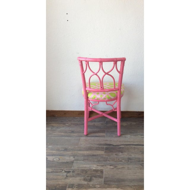 "Vintage Ficks Reed side chair. This darling chair is newly reupholstered in Lilly Pulitzer ""Well Connected"" pink and green..."