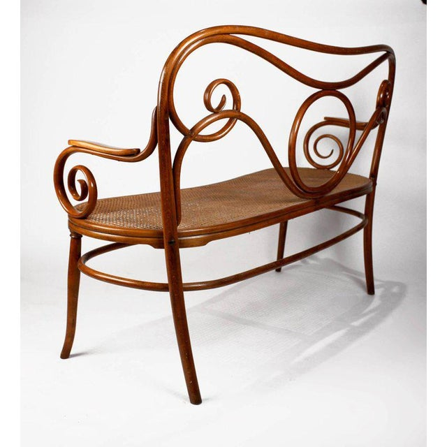 This is an early, rare example of the exceptional work of the Thonet Brothers from Vienna Austria. The settee is in...