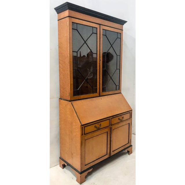 1940s maple Bierdermeier secretary with all original details and two interior shelves. The trim is a glossy black. It has...