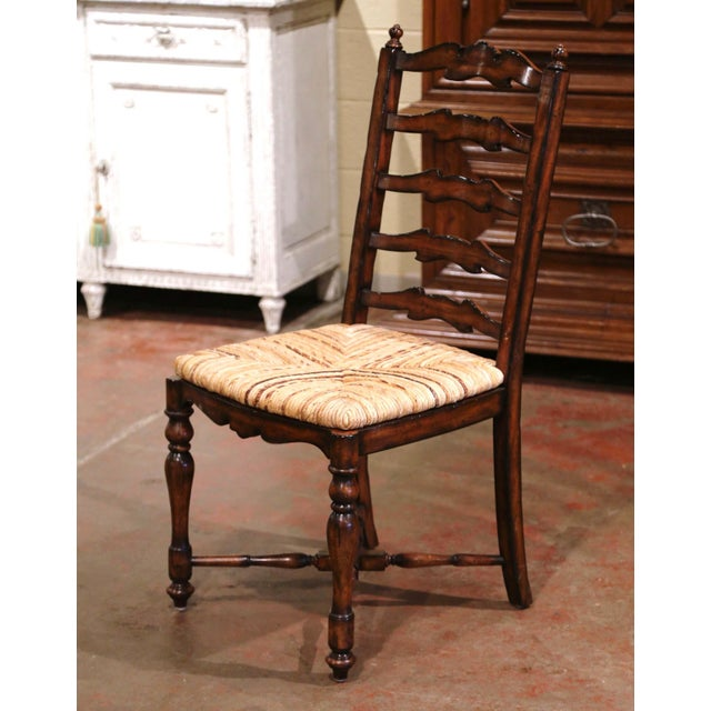 These six elegant country chairs were crafted in France, circa 2000. Carved from solid walnut, each large chair stands on...