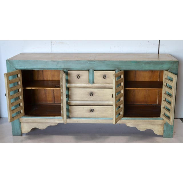 This is a vintage piece that has been refinished and remade to be more functional. The doors and drawers were added to...