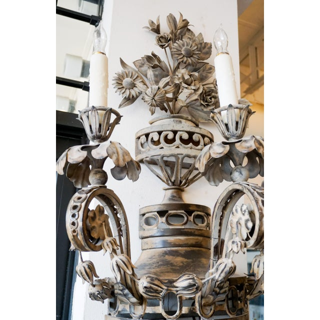 These wall sconces originate from France circa the 1880s. Each features three lights and detailed floral carvings....