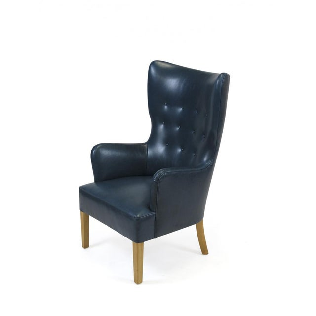 High-back armchair designed by Ole Wanscher for Fritz Hansen, 1946. Newly upholstered in a teal full aniline dyed top-...
