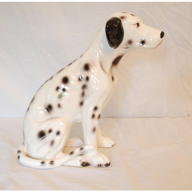 Handsome mid century Dalmatian statue in very good vintage condition. Nicely detailed and has some crazing from age.