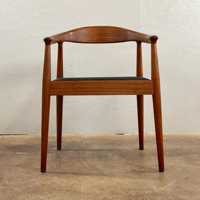 Set of 4 Danish Modern Dining Chairs in the Style of Hans Wegner. Circa 1960's. Chairs are teak and leather padded seats,...