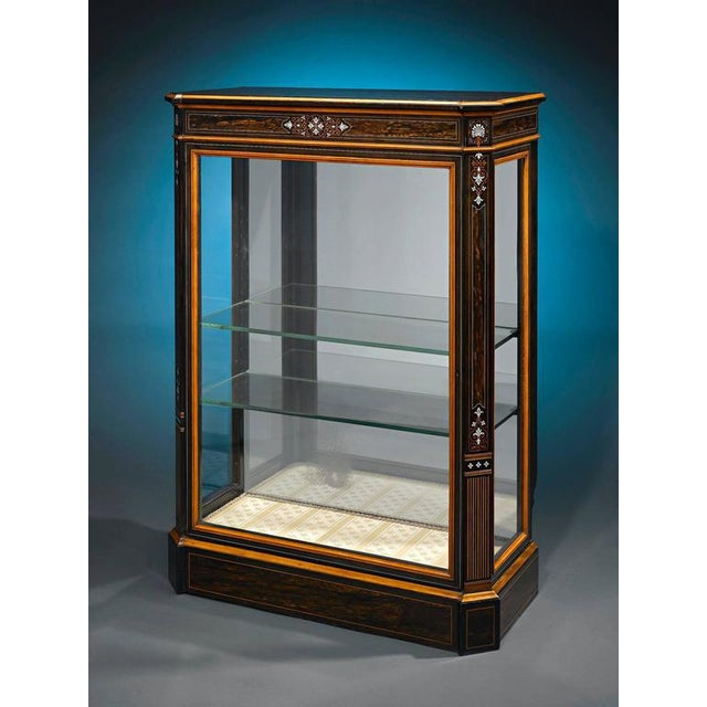 Highly-prized coromandel, or East Indian ebony, was used to create this beautiful Victorian vitrine. Featuring delicate...