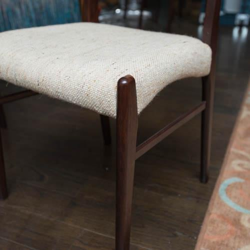 Great original set of ten dining chairs, with one armchair and nine sides. Hard to find in this shape. Fabric is clean.