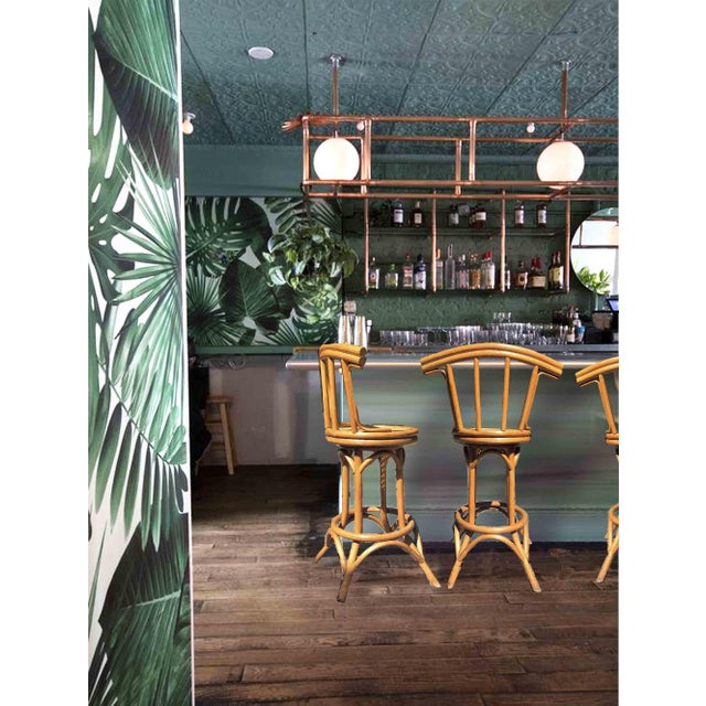 An exceptional set of vintage, bamboo and cane counter height bar stools. This set is in super condition, ready for some...