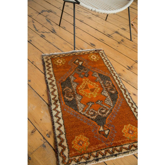 Oversize center medallion with primitive geometric drawing within including rams horn motif. Colors and shades include:...