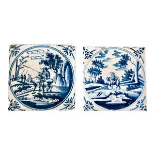 18th Century Delft Blue and White Ceramic Tiles with Country Scenes - a Pair For Sale