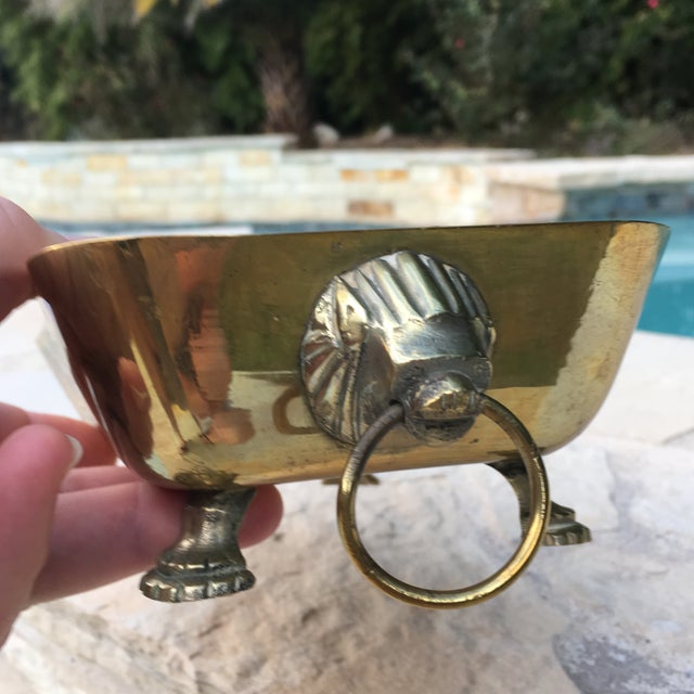 "Vintage dual lions head handled brass square bowl with engraved sides. Measures 9"" long, 5"" wide and 2.5"" tall. Made of..."