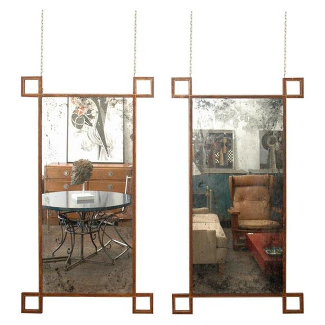 Hand-antiqued mirror inserted into a naturally aged steel and gold leaf detail frame. Discrete holes at the top for flush...