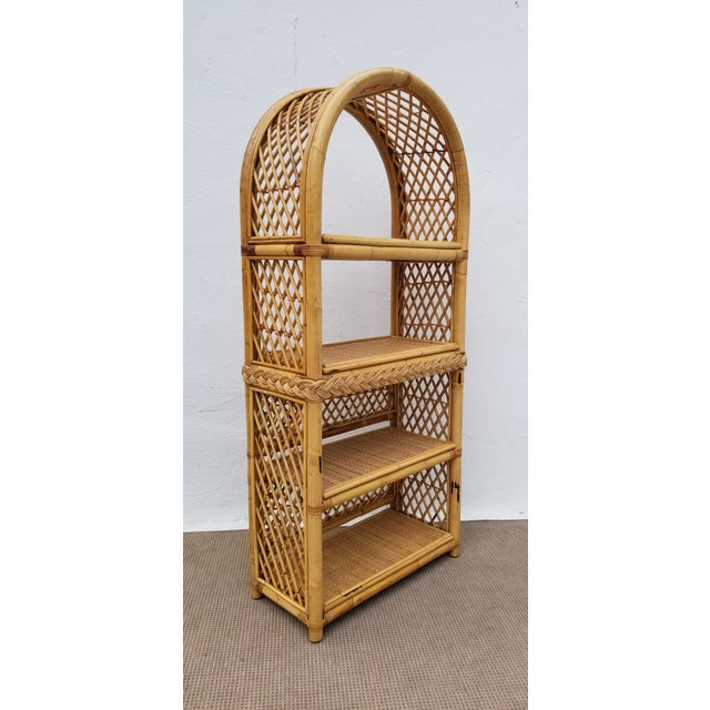 This is a very rare find of Boho Chic Bamboo & Rattan Bookshelf. It features beautiful arched bamboo design with four...