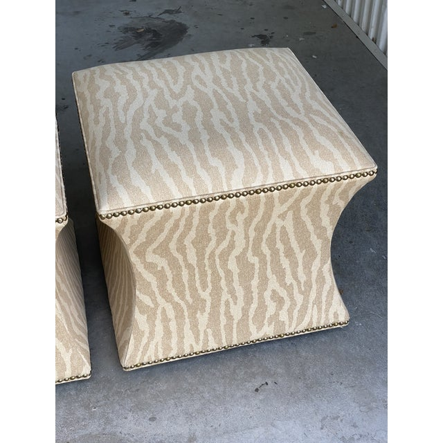 Fabulous pair of leopard ottomans. Lovely curved shapes. Done in a printed wool/cotton. Acquired from a Palm Beach estate.