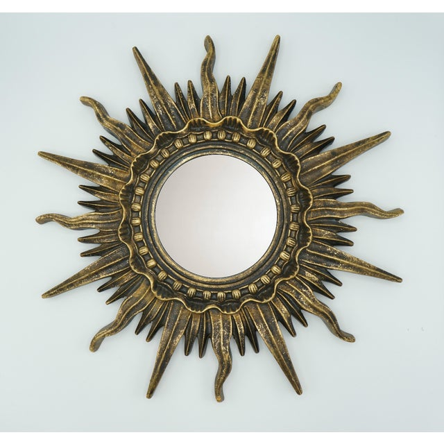 Radiant French Golden Gilt Sunburst Mirror in excellent condition. Stunning and unique! Nail cavity on the back, ready to...