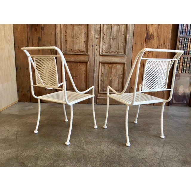 This is a vintage dining set that includes 4 chairs and 1 table. The pieces are rendered in faux twisted rope. Each table...
