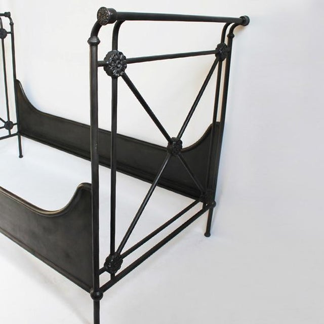 """Hand forged iron daybed. Circular medallion details. 38 X 72 mattress size. Dimensions: 82""""W x 40""""D x 51""""H"""