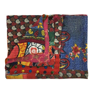 Colorfully Comprised Rug and Relic Kantha Quilt