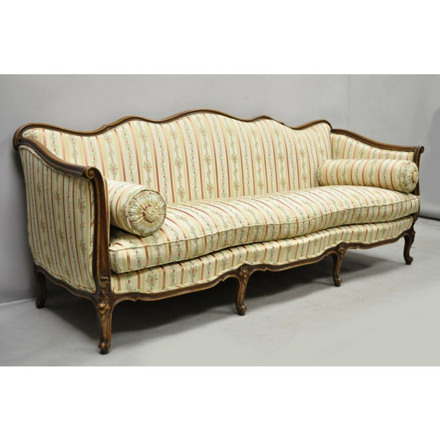 Early 20th Century French Louis XV Provincial Style Sofa with Serpentine Carved Back Originally sold by W & J Sloane. Made...