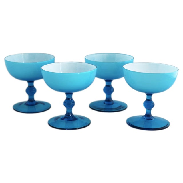 "A set of 8 delicate Carlo Moretti glass coups with blue exterior and white interior from the 1960s. Dimensions: Dia 3.75""..."