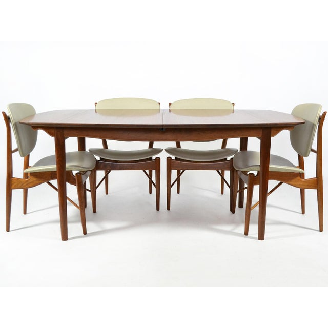 This exquisite dining set by Finn Juhl was designed in 1951 and is Classic Juhl. The sculptural frames of the model FJ 51...