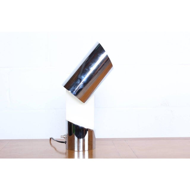 A pivoting chrome table lamp by Arredoluce.