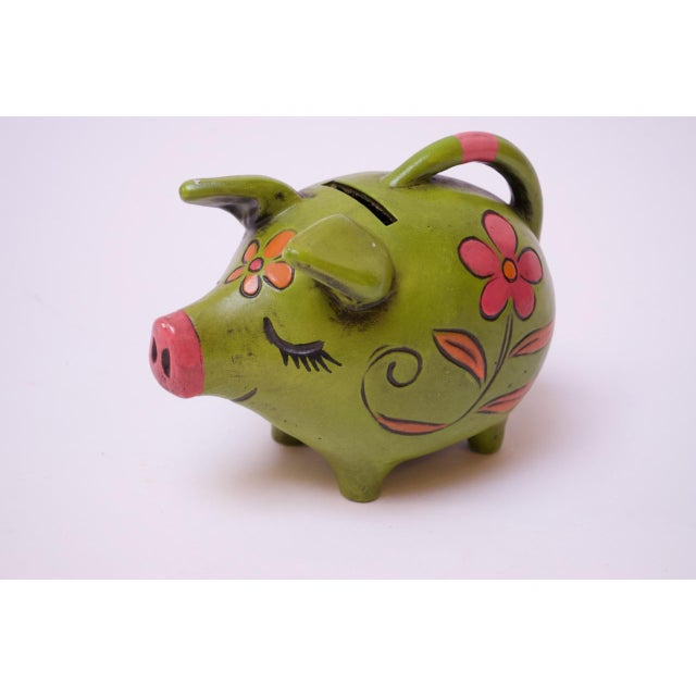 Whimsical 1960s Japanese piggy bank crafted in painted paper mache. Lovely color combination in green, orange, and pink....