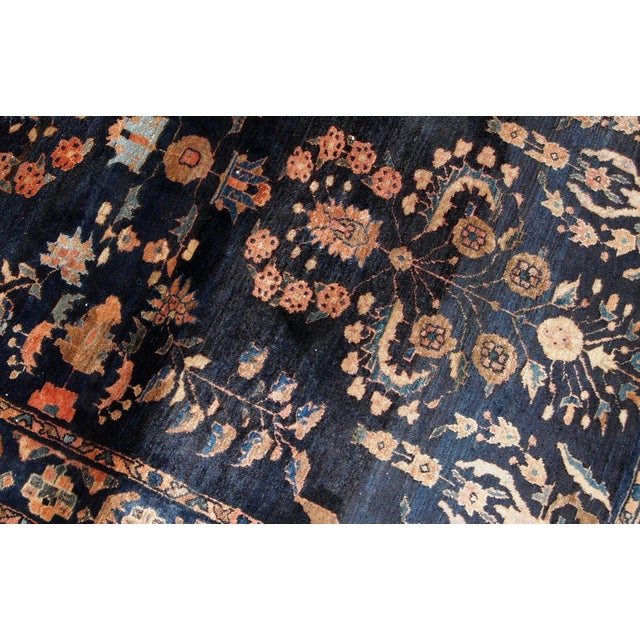 Handmade antique Persian Sarouk rug in original condition, the ends are a little bit missing. The rug is from the...