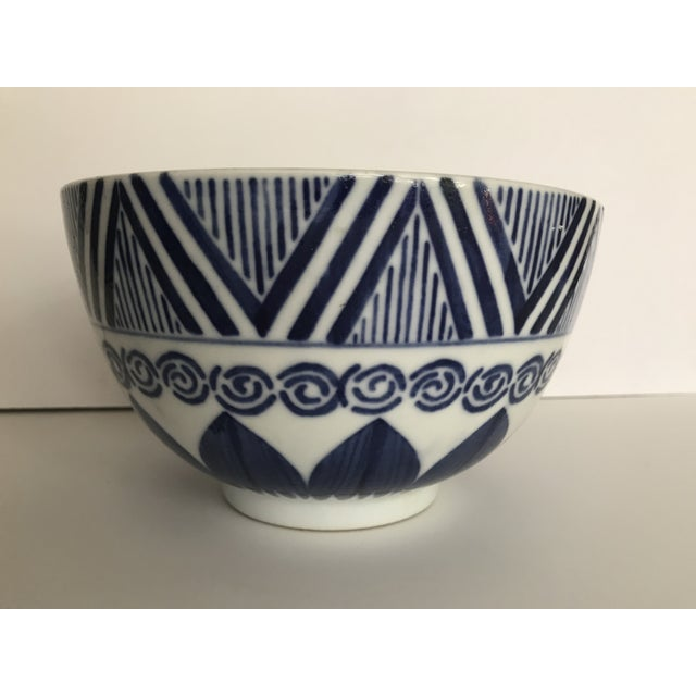 Vintage blue and white ceramic serving bowl. With geometric and swirl patterns throughout, this will add a graphic punch...