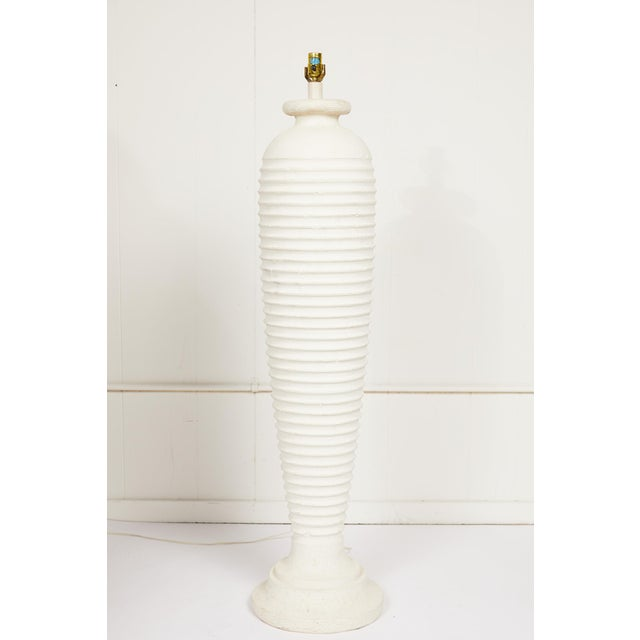 Late 20th Century sculptural urn-shaped distressed plaster floor lamp with horizontal ribbing.
